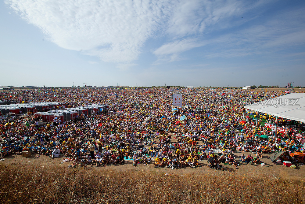 Pilgrims attend a mass celebrated by Pope Pope Benedict XVI at the base of Cuatro Vientos, eight kilometres (five miles) southwest of Madrid on August 21, 2011. The next World Youth Day festival of the Roman Catholic Church will be held in Rio de Janeiro in 2013, Pope Benedict XVI announced Sunday in Madrid