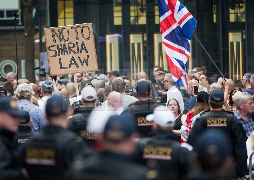 © Licensed to London News Pictures. 11/07/2019. London, UK. Supporters of activist Stephen Yaxley-Lennon Known as Tommy Robinson, gather outside The Old Bailey in London ahead of his sentence. The former leader of the English Defence League (EDL) is being sentenced for contempt of court for filming defendants at a trial at Leeds Crown Court and broadcast the video on social media. Photo credit: Ben Cawthra/LNP