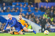 Chelsea midfielder Ross Barkley (8) is tackled by PAOK Salonica midfielder Omar El Kaddouri (7) during the Champions League group stage match between Chelsea and PAOK Salonica at Stamford Bridge, London, England on 29 November 2018.
