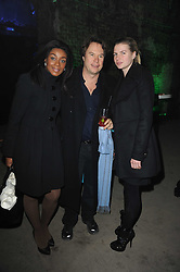 Left to right, PHOEBE VELA, JOHN HITCHCOX and his daughter PIA HITCHCOX at the launch of 2 collections by jeweller Stephen Webster - ÔThe 7 Deadly SinsÕ and ÔNo RegretsÕ held at The Old Vics Tunnels, Under Waterloo Station, Off Leake Street, London SE1 on 8th December 2010.<br /> Left to right, PHOEBE VELA, JOHN HITCHCOX and his daughter PIA HITCHCOX at the launch of 2 collections by jeweller Stephen Webster - 'The 7 Deadly Sins' and 'No Regrets' held at The Old Vics Tunnels, Under Waterloo Station, Off Leake Street, London SE1 on 8th December 2010.
