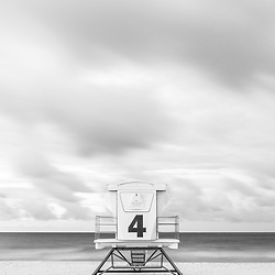 Pensacola Beach Florida lifeguard tower four on Casino Beach. Pensacola Beach is on Santa Rosa Island in the Emerald Coast area of the Southeastern United States of America. Photo is black and white, vertical and high resolution. Copyright ⓒ 2018 Paul Velgos with All Rights Reserved.