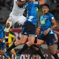 Lukhanyo Am beats Blues fullback Michael Collins to a high ball during the Super Rugby match between the Blues and Sharks at Eden Park in Auckland, New Zealand on Saturday, 31 March 2018. Photo: Dave Lintott / lintottphoto.co.nz