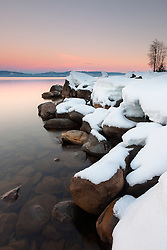 """Sunset at Lake Tahoe 33"" - Photograph at sunset of snow covered boulders along the shore of Lake Tahoe, near Kaspian Point in Hurricane Bay."