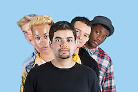 Portrait of multi-ethnic friends standing in line over blue background