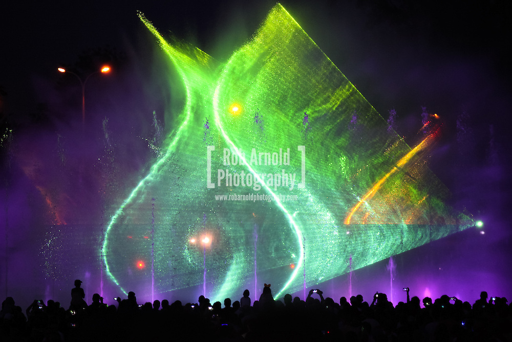 © Rob Arnold.  23/05/2014. Warsaw, Poland. Lights projecting on a curtain of water spray during a light show at the Multimedialny Park Fontann, Warsaw, Poland. Photo credit : Rob Arnold