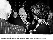 Prince Rupert Loewenstein & Joan Collins at a book party given for John Richardson. M.O.M.A. New York. 20/3/91. Film 91137f36<br />