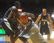 """Ole Miss forward Terrance Henry (1) dribbles against East Tennessee State's Isiah Brown (41) at the C.M. """"Tad"""" Smith Coliseum in Oxford, Miss. on Saturday, December 18, 2010. Ole Miss won 71-50."""