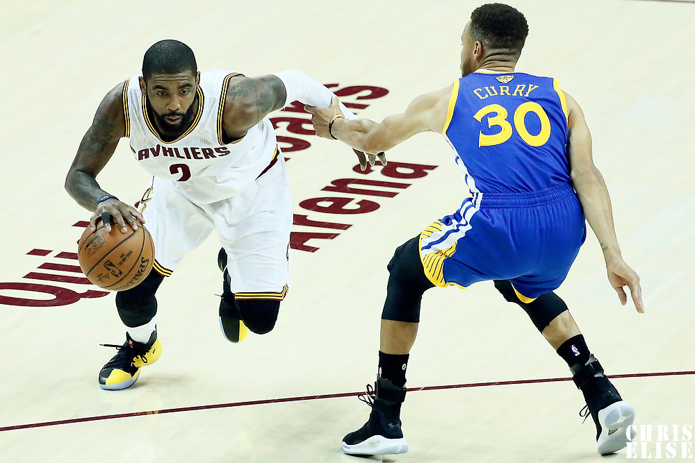 07 June 2017: Cleveland Cavaliers guard Kyrie Irving (2) drives past Golden State Warriors guard Stephen Curry (30) during the Golden State Warriors 118-113 victory over the Cleveland Cavaliers, in game 3 of the 2017 NBA Finals, at  the Quicken Loans Arena, Cleveland, Ohio, USA.