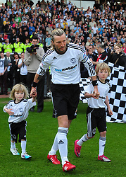 Derby County's Robbie Savage plays his last game at Pride Park before retiring from football walks out with his two children - Photo mandatory by-line: Joe Meredith/JMP - 30/04/2011 - SPORT - FOOTBALL - Championship - Derby County v Bristol City  - Pride Park, Derby, England