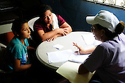 A young boy and his mother listen to a doctor from the 'Nefrolempa' health project, explain the results of their medical tests, as part of a series of medical investigations into the high incidence of chronic renal failure in the region.<br /> <br /> Community of Nueva Esperanza, Bajo Lempa, El Salvador. 2011<br /> The 'Nefrolempa' research project is a collaboration between the El Salvador Ministry of Health, the Nephrology Institute of Cuba's Ministry for Public Health and the United Bajo Lempa Committee Association. The aim of the project is to investigate the reasons for the high levels of Chronic Kidney Disease (CKD) suffered by the communities within the Bajo Lempa region. It is exploring whether the use of agrochemicals might be a factor in the prevalence of the disease.