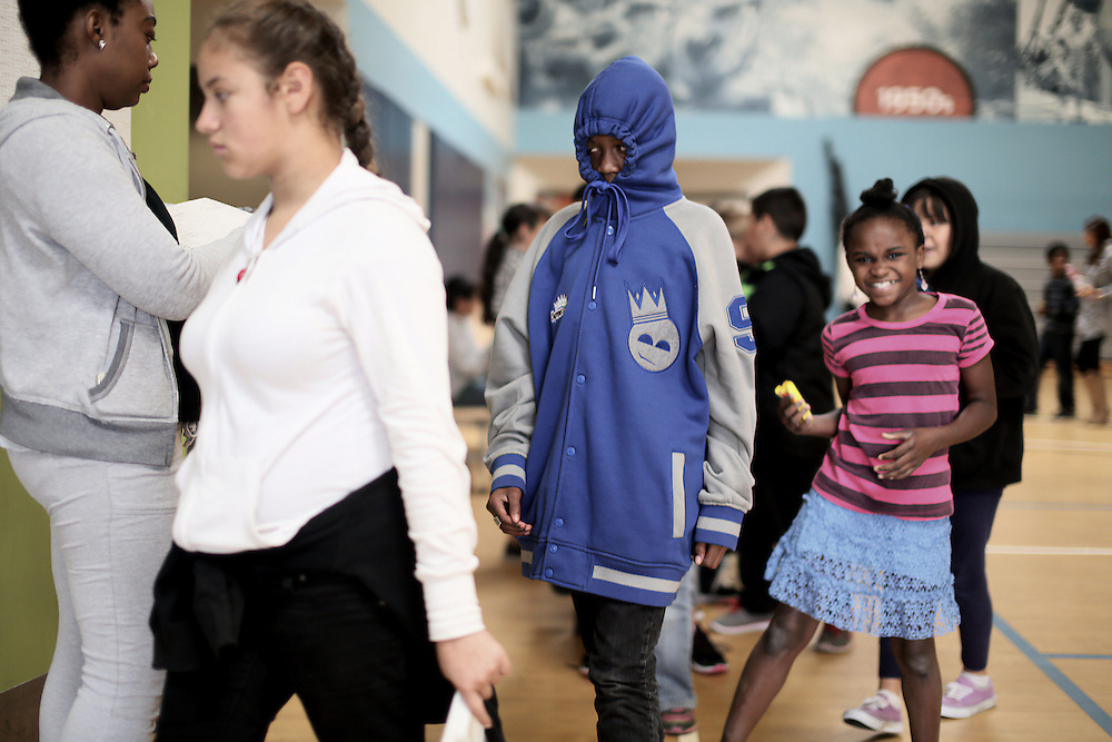 Students line up during lunch period at the Monarch School in San Diego, CA on Friday, May 15, 2015.  The Monarch School is the largest elementary through High School facility that caters to students that are homeless or are have associations with homelessness.(Photo by Sandy Huffaker for The Atlantic)