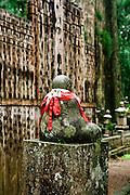 Dressed Buddha figure.