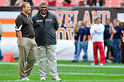 Sept. 19, 2010; Cleveland, OH, USA; Cleveland Browns head coach Eric Mangini (left) talks with former Browns Head Coach and current Kansas City Chiefs defensive coordinator Romeo Crennel (right) prior to the game at Cleveland Browns Stadium. Mandatory Credit: Jason Miller-US PRESSWIRE