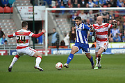 Sam Morsy (8) of Wigan Athletic and Richard Chaplow (8) of Doncaster Rovers fight for ball during the Sky Bet League 1 match between Doncaster Rovers and Wigan Athletic at the Keepmoat Stadium, Doncaster, England on 16 April 2016. Photo by Ian Lyall.