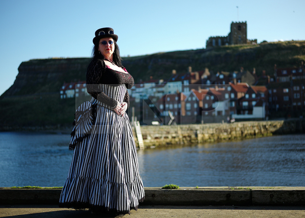 © Licensed to London News Pictures. <br /> 01/11/2014. <br /> <br /> Whitby, Yorkshire, United Kingdom<br /> <br /> Lynne Slater from Peterlee poses for a picture during the Whitby Goth Weekend. <br /> <br /> The event this weekend brings together thousands of extravagantly dressed followers of Victoriana, Steampunk, Cybergoth and Romanticism who all visit the town to take part in celebrating Gothic culture. This weekend marks the 20th anniversary since the event was started by local woman Jo Hampshire.<br /> <br /> Photo credit : Ian Forsyth/LNP