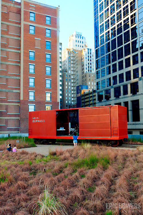 Vertical photo of the Prairie Logic boxcar performance venue on the green roof at downtown Kansas City's Power and Light District.