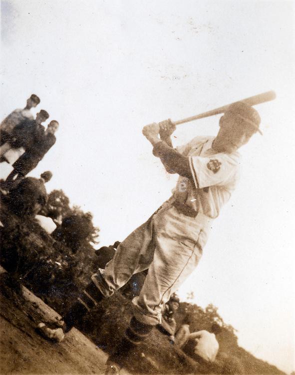 Japanese person playing baseball ca 1940s