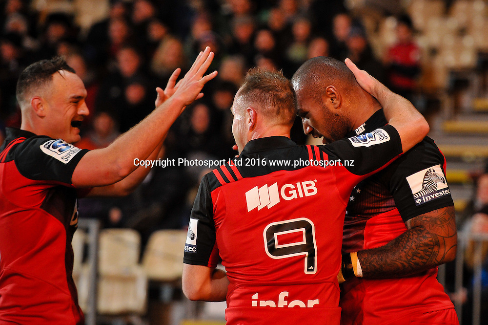 Israel Dagg of the Crusaders Andy Ellis of the Crusaders celebrates Nemani Nadolo of the Crusaders try during the Super Rugby Match, Crusaders V Rebels, AMI Stadium, Christchurch, New Zealand. 9th July 2016. Copyright Photo: John Davidson / www.photosport.nz