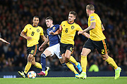 Scotland midfielder Ryan Christie (20) (Celtic) drives through the Belgium defence  during the UEFA European 2020 Qualifier match between Scotland and Belgium at Hampden Park, Glasgow, United Kingdom on 9 September 2019.