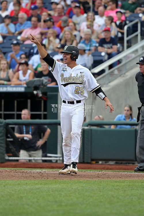 Karl Ellison #25 of the Vanderbilt Commodores celebrates during Game 2 of the 2014 Men's College World Series between the Vanderbilt Commodores and Louisville Cardinals at TD Ameritrade Park on June 14, 2014 in Omaha, Nebraska. (Brace Hemmelgarn)