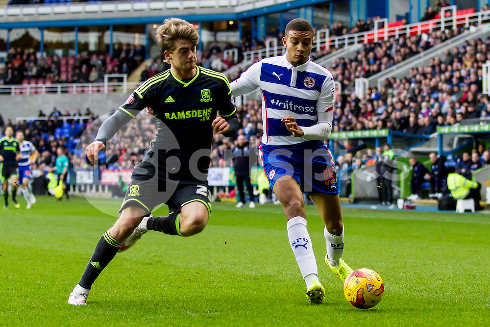Michael Hector of Reading sees the ball out while coming under pressure during the Sky Bet Championship match between Reading and Middlesbrough at the Madejski Stadium, Reading, England on 10 January 2015. Photo by Gareth  Brown.
