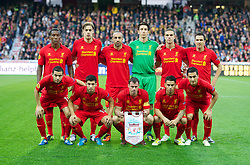 BERNE, SWITZERLAND - Thursday, September 20, 2012: Liverpool's players line up for a team group photograph before the UEFA Europa League Group A match against BSC Young Boys at the Wankdorf Stadion. Back row L-R: Andre Wisdom, Sebastian Coates, Jose Enrique, goalkeeper Brad Jones, Jordan Henderson, Stewart Downing. Front row L-R: Oussama Assaidi, Daniel Pacheco, captain Jamie Carragher, 'Suso' Jesus Joaquin Fernandez Saenz De La Torre, Nuri Sahin. (Pic by David Rawcliffe/Propaganda)