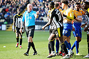 Referee Lee Mason wants a word with Notts County midfielder Enzio Boldewijn (11) during the EFL Sky Bet League 2 match between Notts County and Mansfield Town at Meadow Lane, Nottingham, England on 16 February 2019.