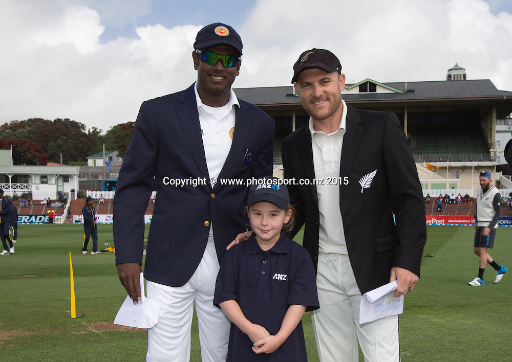 ANZ coin toss winner with the captains, Brendon McCullum and Angelo Mathews.  First day, second test, ANZ Cricket Test series, New Zealand Black Caps v Sri Lanka, 03 January 2015, Basin Reserve, Wellington, New Zealand. Photo: John Cowpland / photosport.co.nz