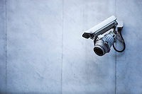 Close-up of CCTV security camera on wall