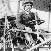 Samuel Franklin Cody  (1862-1913) in his biplane. American-born British aviator.