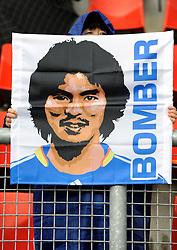 A fan holds up a banner celebrating Yuji Nakazawa of Japan
