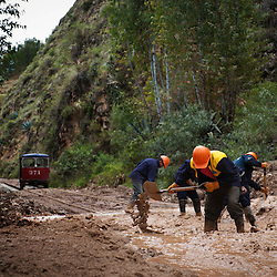 A crew of workers clears the tracks. During the rainy season, January to March, the route is heavily affected by landslides. Some can be cleared from the tracks in less than an hour while others force the tren macho to turn around and head back home.