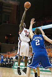 Virginia's Mamadi Diane (24) shots over Duke's Josh McRoberts (2).  The University of Virginia Cavaliers beat the #8 ranked Duke University Blue Devils 68-66 in overtime at the John Paul Jones Arena in Charlottesville, VA on February 1, 2007...