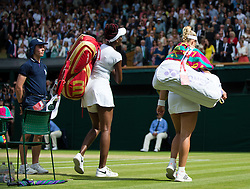 LONDON, ENGLAND - Thursday, July 7, 2016:  Angelique Kerber (GER) and Venus Williams walking off court after A. Kerber won the Ladies' Singles - Semi-finals match on day eleven of the Wimbledon Lawn Tennis Championships at the All England Lawn Tennis and Croquet Club. (Pic by Kirsten Holst/Propaganda)