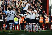 Tottenham Hotspur celebrate their fifth goal during the Barclays Premier League match between Bournemouth and Tottenham Hotspur at the Goldsands Stadium, Bournemouth, England on 25 October 2015. Photo by Mark Davies.