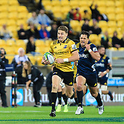 Beauden Barrett runs with the bay during the super rugby union  game between Hurricanes  and Highlanders, played at Westpac Stadium, Wellington, New Zealand on 24 March 2018.  Hurricanes won 29-12.
