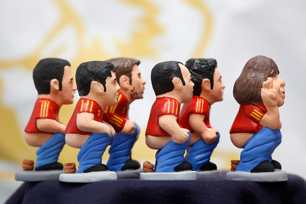 "November 10,  2010. A company in Torroella de Montgrí (Girona, Spain) called ""Caganer.com"", which specializes in the production of ""caganers"", unveiled today its new figurine for Christmas, Michael Jackson, Josn Lennon or prince Charles. .A ""Caganer"" is a small figure from Catalonia, usually made of fired clay, which depicts as squatting person in the act defecating..""Caganer"" is Catalan for pooper. It forms part of one of the typical figures of the manger or ""Nativity"" scene together with Mary, Joseph and the baby Jesus but hidden in a corner. It is a humorous figure, originally portraying a peasant wearing a ""barretina"" (a red stocking hat), and seems to date from the 18th century when it was believed that the figure's deposits would fertilize the earth to bring a prosperous year. With the course of time, the original personage of this pooping figure was substituted with personalities from the political and sports worlds and other famous personalities..The spanish football national team won the FIFA Worldcup 2010 in South Africa. From left to right Sergio Busquets, David Villa, Gerard Pique, Andres Iniesta, Xavi Hernandez and Carles Puyol."