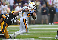 September 3, 2011: Tennessee Tech Golden Eagles running back Cody Forbes (23) tries to pull away from Iowa Hawkeyes' Nick Nielsen (29) during the first half of the game between the Tennessee Tech Golden Eagles and the Iowa Hawkeyes at Kinnick Stadium in Iowa City, Iowa on Saturday, September 3, 2011. Iowa defeated Tennessee Tech 34-7 in a game stopped at one point due to lightning and rain.