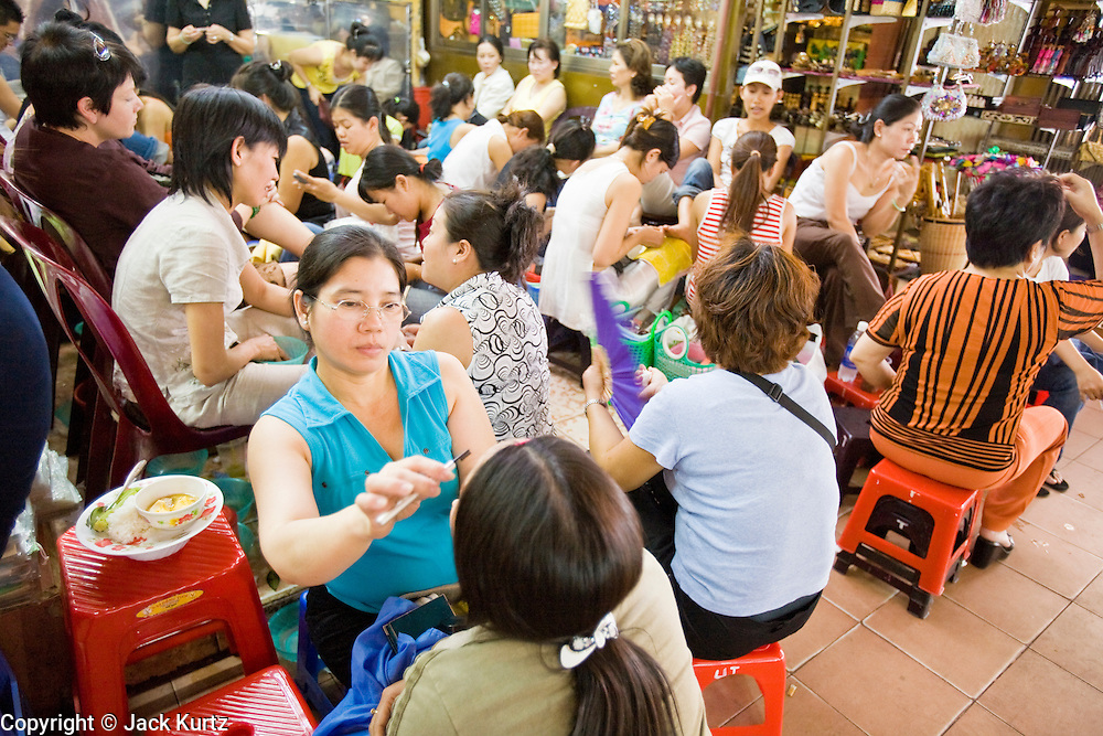 09 MARCH 2006 - HO CHI MINH CITY, VIETNAM: Beauticians at work in Ben Thanh Market in Ho Chi Minh City (formerly Saigon), Vietnam. Photo by Jack Kurtz