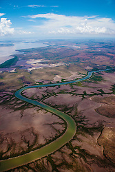 An aerial landscape view of a winding river on the east Kimberley coast .