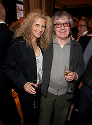 LONDON, ENGLAND - APRIL 07: Bill Wyman and Suzanne Accosta attend the reveal of Gerald Scarfe's exclusive artwork at Scarfes Bar, Rosewood London on April 7, 2014 in London, England.  (Photo by Mike Marsland/WireImage for Rosewood Hotels and Resorts)