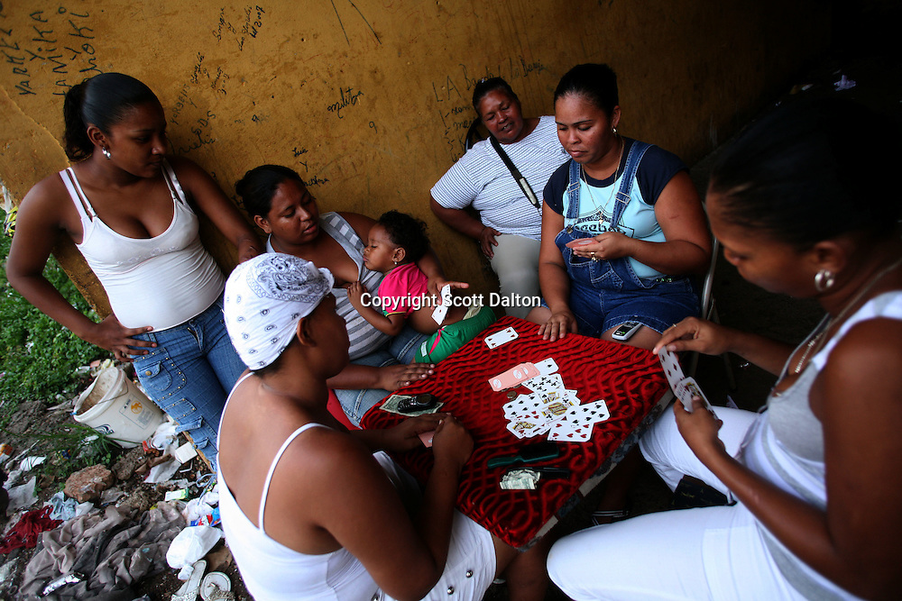 Women play cards in San Miguel, a poor barrio in Panama City, Panama on Saturday, September 8, 2007. (Photo/Scott Dalton).