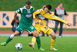 Sebastjan Cimirotic of Olimpija vs Miral Samardzic of Maribor at 13th Round of Prva Liga football match between NK Olimpija and Maribor, on October 17, 2009, in ZAK Stadium, Ljubljana. Maribor won 1:0. (Photo by Vid Ponikvar / Sportida)