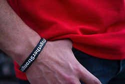 """LYON, FRANCE - Tuesday, July 5, 2016: A Wales supporter wears a wristband bearing the words """"Together Stronger"""" in Lyon ahead of the UEFA Euro 2016 Championship Semi-Final match against Portugal at the Stade de Lyon. (Pic by Paul Greenwood/Propaganda)"""