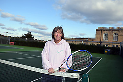 Woman playing tennis, UK. MR Posed by model