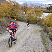 Alan MacDonald (front) in action during the New World Tour de Wakatipu bike race on Saturday. Six hundred and ninety people entered the bike race which featured an  exclusive course with breathtaking views from Millbrook Resort in Arrowtown to Chard Farm along the Kawarau River, via the trails and tracks of the Wakatipu basin with distances of 36 kilometres fun riding for recreational bikers and 45 kilometres for elite and sport racers. The event was part of the inaugural Queenstown Bike Festival, which took place from 16th-25th April. The event hopes to highlight Queenstown's growing profile as one of the three leading biking centres in the world. Queenstown, Central Otago, New Zealand. 23rd April 2011. Photo Tim Clayton..