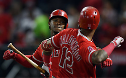 June 6, 2018 - Anaheim, CA, U.S. - ANAHEIM, CA - JUNE 06: Los Angeles Angels of Anaheim designated hitter Justin Upton (8) is greeted by catcher Martin Maldonado (12) after Upton hit a solo home run in the seventh inning of a game against the Kansas City Royals played on June 6, 2018 at Angel Stadium of Anaheim in Anaheim, CA. (Photo by John Cordes/Icon Sportswire) (Credit Image: © John Cordes/Icon SMI via ZUMA Press)