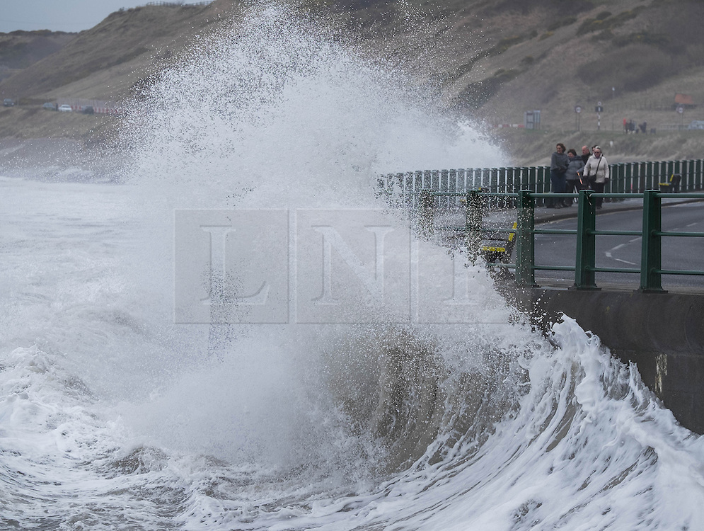 © Licensed to London News Pictures. <br /> 21/03/2015. <br /> <br /> Sandsend, North Yorkshire.<br /> <br /> Huge waves crash against the sea wall at Sandsend in North Yorkshire. The exceptionally high Spring tides were created by the moon's 18-year cycle.<br /> <br /> Photo credit : Ian Forsyth/LNP