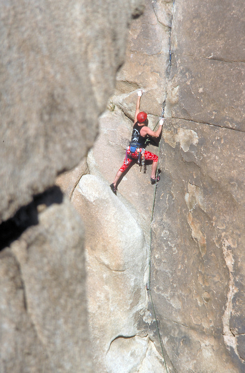 Rock climber scales extreme wall