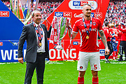 Lee Bowyer of Charlton Athletic (Manager) and Patrick Bauer of Charlton Athletic (5) with the play off trophy during the EFL Sky Bet League 1 play off final match between Charlton Athletic and Sunderland at Wembley Stadium, London, England on 26 May 2019.